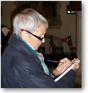 "Diana Freeman, a former Organiser of Woking DFAS's Heritage Volunteering, is seen here taking notes of ""woodwork"" details"