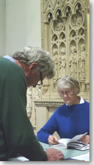 John Gill and Barbara Britten were working on the stone reredos behind the main altar.