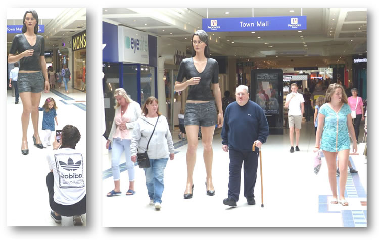 woking statue of woman in shopping mall